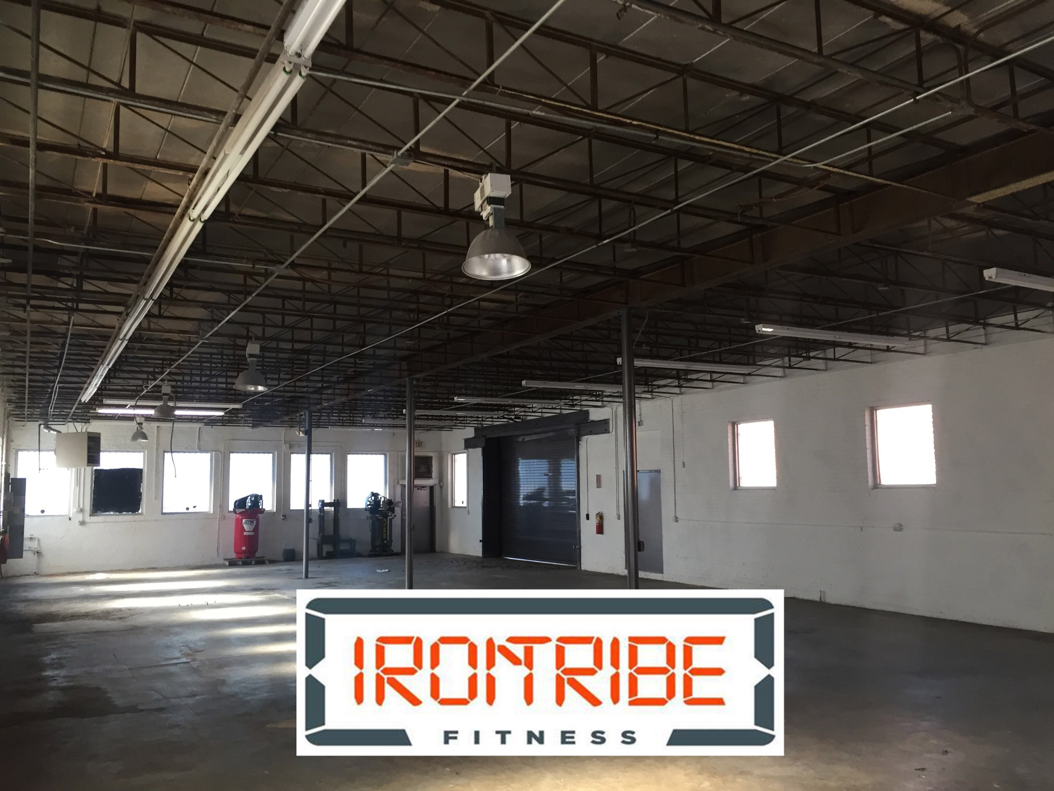 Iron Tribe Fitness will move into the industrial warehouse space pictured above.