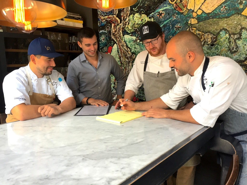 From left to right: Line cook Raul Dominguez, Castellucci, Executive chef Landon Thompson, and sous chef Andy Montesano talk shop prior to a busy evening at Cooks & Soldiers. Photo: Frank Reddy